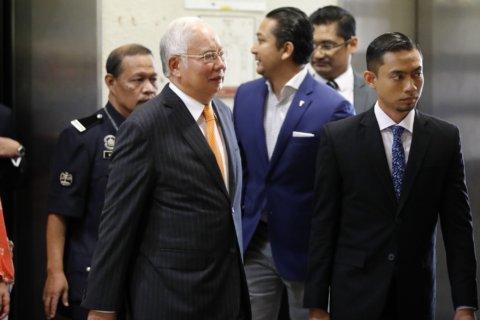The Latest: Judge orders Najib to enter defense in 1MDB case