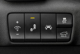 Close up shot of a modern car electronic safety systems controle panel