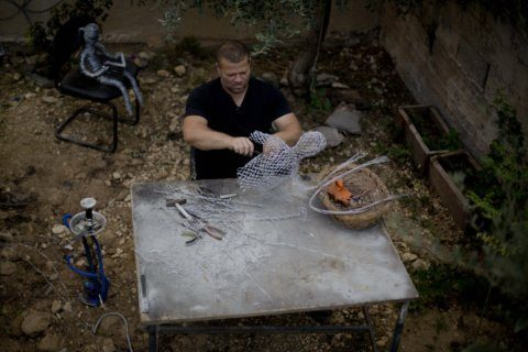 Palestinian photographer finds 2nd calling as wire sculptor