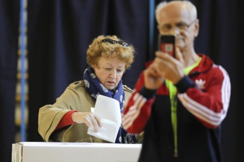 The Latest: Exit polls see runoff in Romania president vote