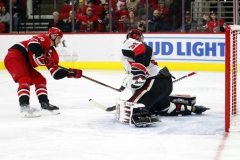 Aho scores 2 to lead Hurricanes past Senators 8-2