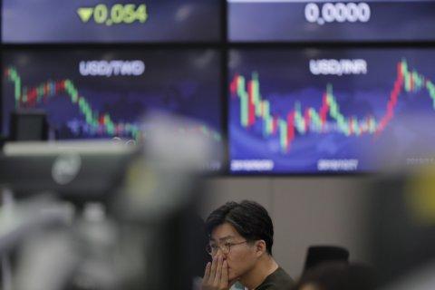 World shares mostly slide in 'Black Friday' retreat