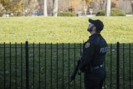 A uniformed Secret Service Officer patrols the White House grounds during a lockdown due to an airspace violation, Tuesday, Nov. 26, 2019, in Washington. (AP Photo/ Evan Vucci)