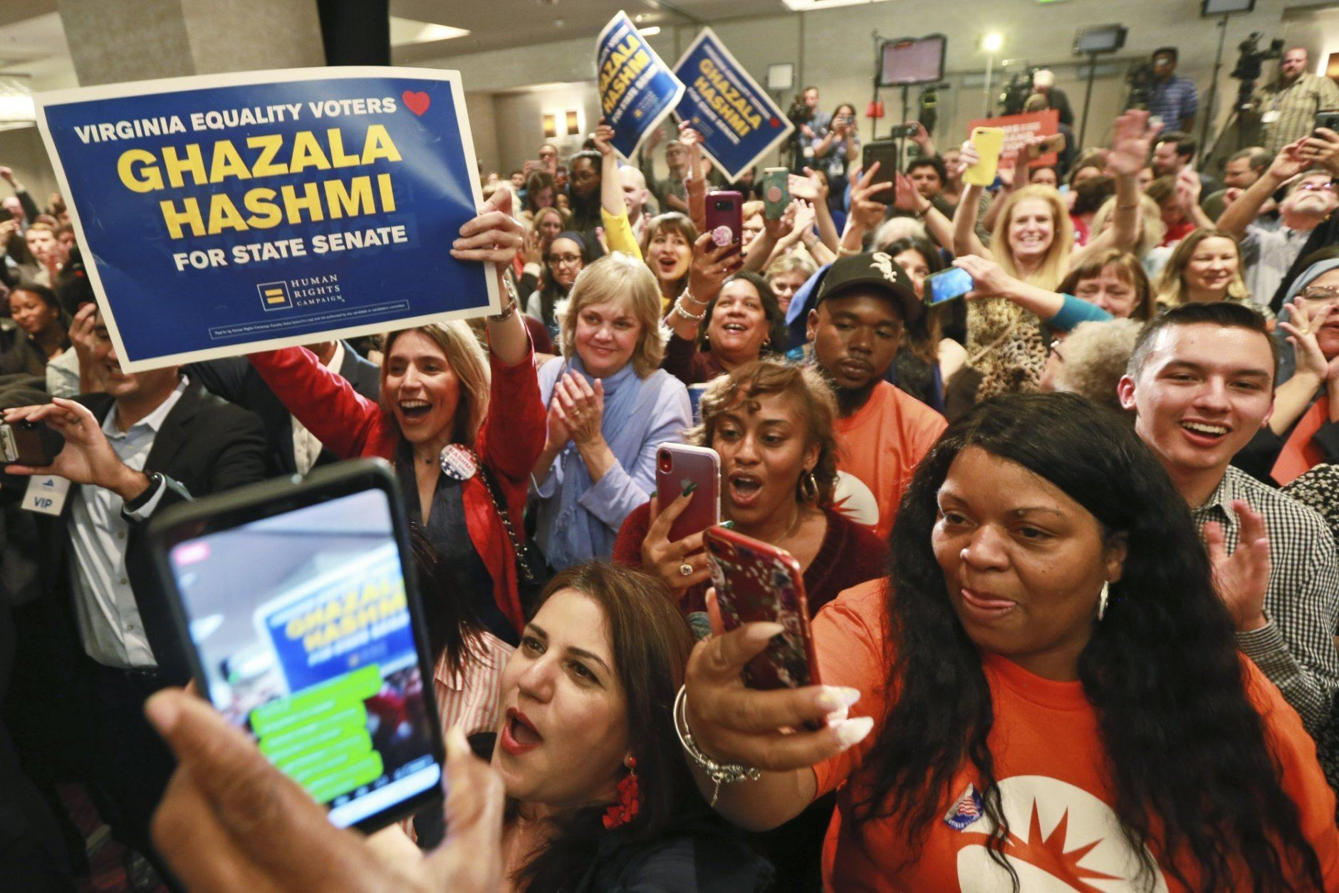 Democratic supporters cheer at their party in Richmond, Va., Tuesday, Nov. 5, 2019. All seats in the Virginia House of Delegates and State Senate are up for election. (AP Photo/Steve Helber)