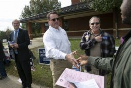State Sen. Bryce Reeves greets voters outside Smith Station Elementary School on Election Day in Spotsylvania, Va., Tuesday, Nov. 5, 2019. (Mike Morones/The Free Lance-Star via AP)