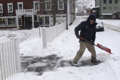 The Latest: Snow, icy conditions hit Northeast, South