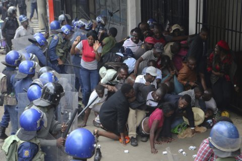 Zimbabwe police fire tear gas at opposition supporters