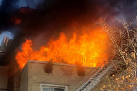 DC firefighters responding to large fire in 3-story apartment building