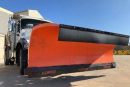 Rubber-tipped snow plow blades