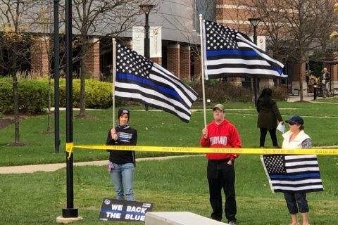 'Thin Blue Line' flag supporters greet Hogan, Elrich in Montgomery Co.