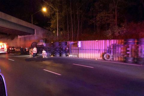 Overturned tractor-trailer hauling mangoes causes problems on Outer Loop