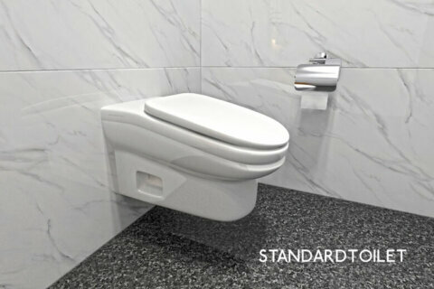 Uncomfortable toilet slopes forward to keep bathroom breaks short