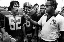"""Alexandria, Va's., T.C. Williams High School football coach Herman Boone, right, during a break at summer camp, in 1971, with guard Johnny Colantuoni, (62) and John Vaughn, center. The famous 1971 team will be memorialized by Denzel Washington and Disney films in """"Remember the Titans."""" (AP Photo)"""