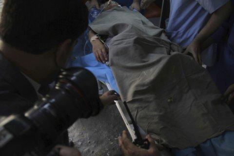 Afghans hold candlelight vigil for slain Japanese doctor