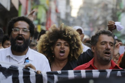 Brazilian slum residents protest after 9 die in police raid