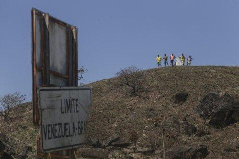 Rights group: Venezuela migrant kids left at risk in Brazil