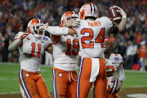 LSU cruises, Clemson survives for title game clash