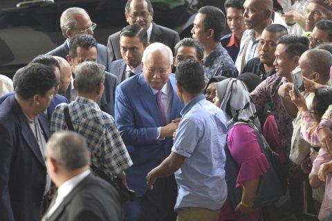Malaysia's ex-PM Najib seeks to show he's victim of fugitive