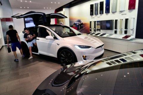 California cuts electric-car rebates, drops luxury models