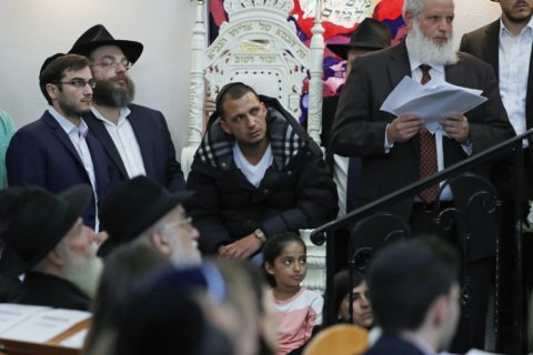 Shooting survivor sues Southern California synagogue