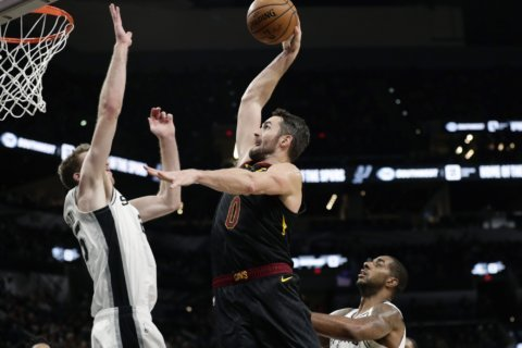 Love, Cavs rally by Spurs 117-109 in OT to snap 8-game skid