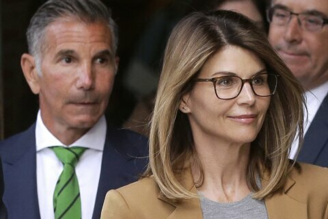 New filing in college bribery case against Loughlin, husband