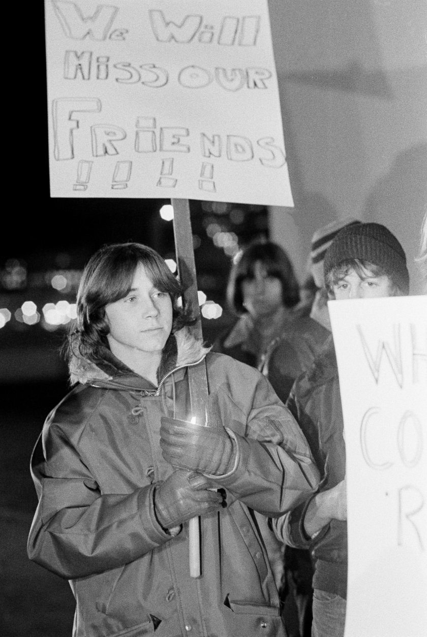FILE - In this Dec. 4, 1979 file photo, a young man shields his candle from the wind during a memorial service for those killed during a stampede at a rock concert by the British rock band The Who at Cincinnati riverfront coliseum in Cincinnati, Ohio. (AP Photo/Brian Horton, File)