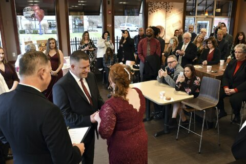 Couple return for a 2nd dunk at Dunkin', this time with vows