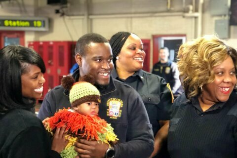 'She's my Christmas gift': DC firefighters reunite with baby they saved