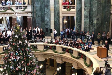 Wisconsin governor lights 'holiday' tree; choir sings carols