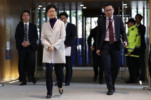Hong Kong leader says new US law, violence will harm economy
