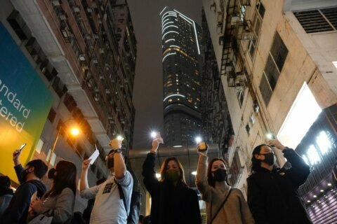 Revelers, protesters to see in the new year in Hong Kong