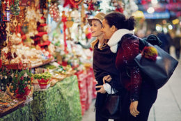 Girlfriends are choosing gifts at the christmas market