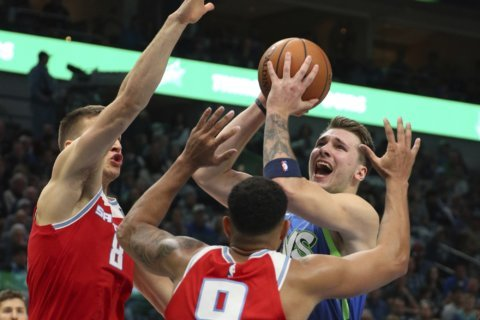 Bjelica scores 30; Kings withstand rally, beat Mavs 110-106