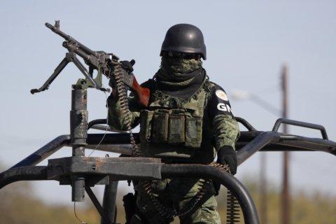 Mexico raises to 24 death toll in border gunbattles
