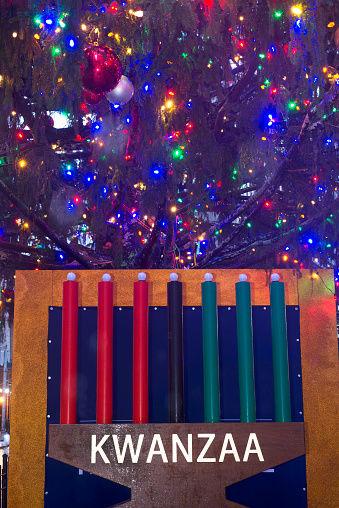 December 16th, 2018, NYC. Kwanzaa display under Christmas tree on Broad Street, Manhattan, NY.