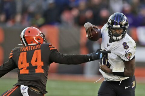 Ravens clinch AFC's top seed by beating Browns 31-15