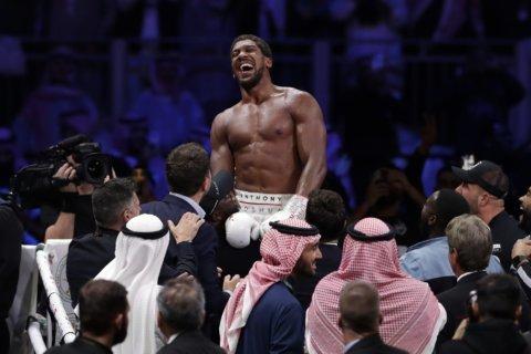 Joshua set to defend heavyweight titles at Tottenham stadium