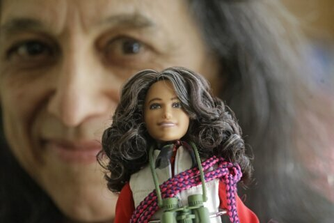 Forest ecologist helps refashion Barbie dolls as scientists