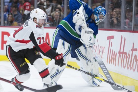 Roussel scores in return, Canucks beat Senators 5-2