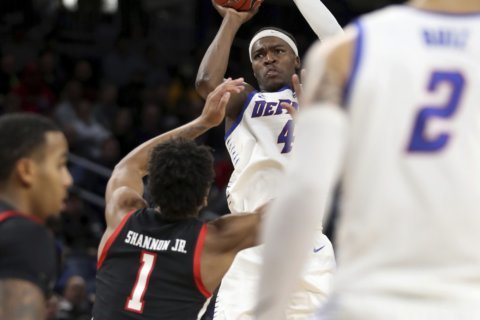 DePaul tops Texas Tech 65-60 in OT behind Coleman-Lands
