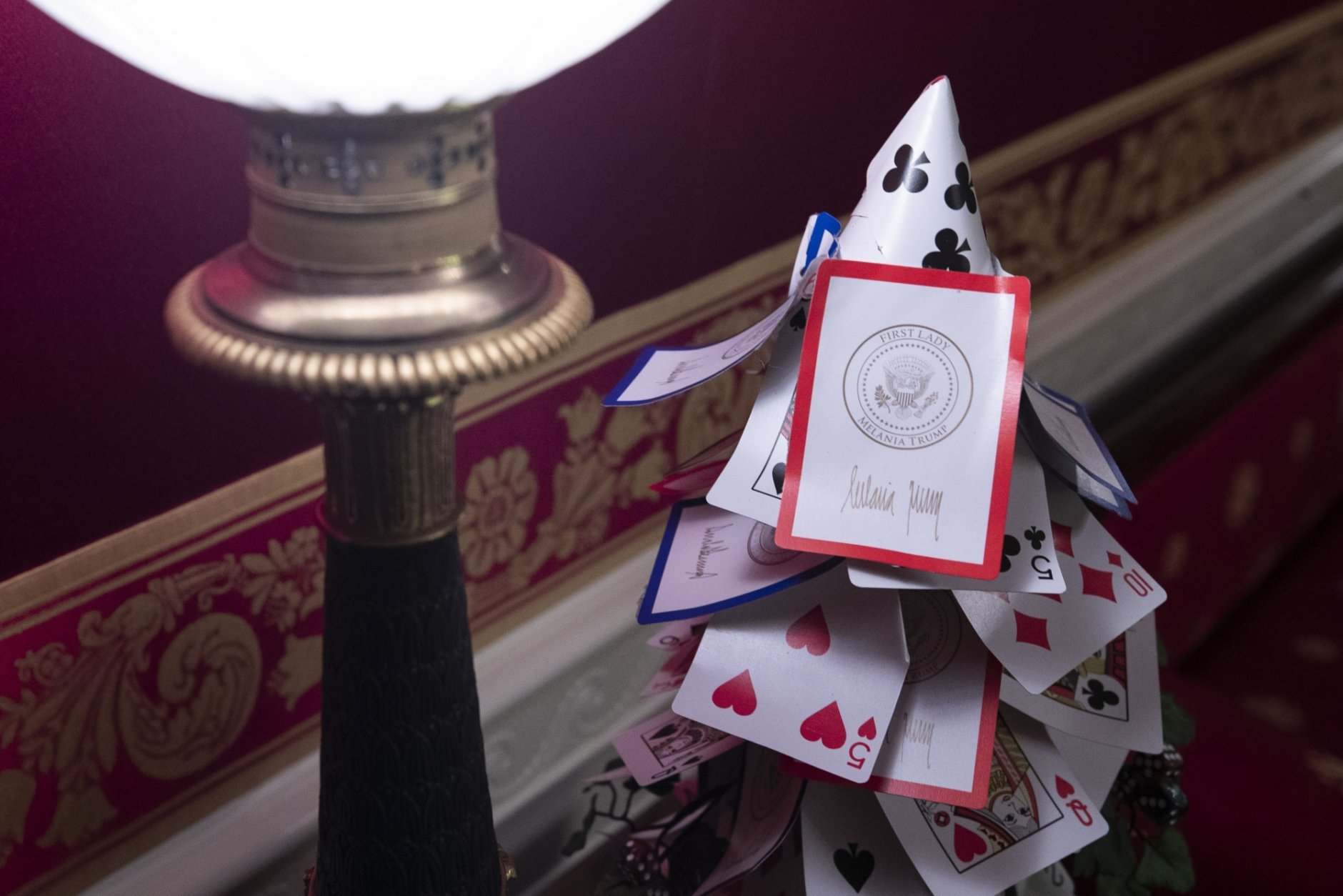 The Red Room is decorated with games, including a tree made of White House playing cards during the 2019 Christmas preview at the White House, Monday, Dec. 2, 2019, in Washington. (AP Photo/Alex Brandon)