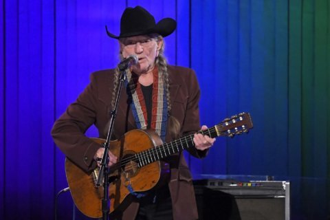 Willie Nelson says he's not smoking, but is still using pot