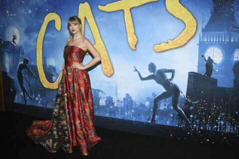 Andrew Lloyd Webber beams as 'Cats' film has its premiere