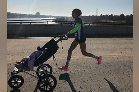 Mom sets likely world record for half-marathon while pushing a stroller