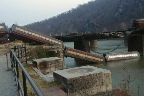 Freight train tumbles into Potomac after derailment on bridge in Harpers Ferry