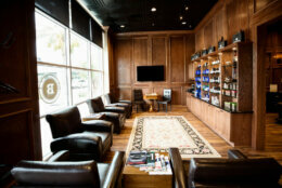 "Boardroom Salons, as much leather-chaired lounges as barbershops, provides what it calls a ""country club experience."" Services offered include hair and shave services, manicures, and facial massages, along with complimentary drinks"