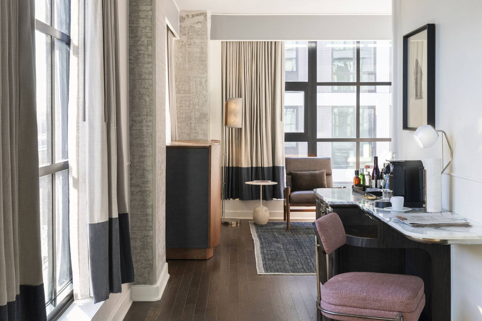 A suite in the Thompson D.C. in the Capitol Riverfront's Navy Yard Neighborhood. The hotel's 225 rooms and suites all have floor-to-ceiling windows and views of the Anacostia River and Nationals Park.