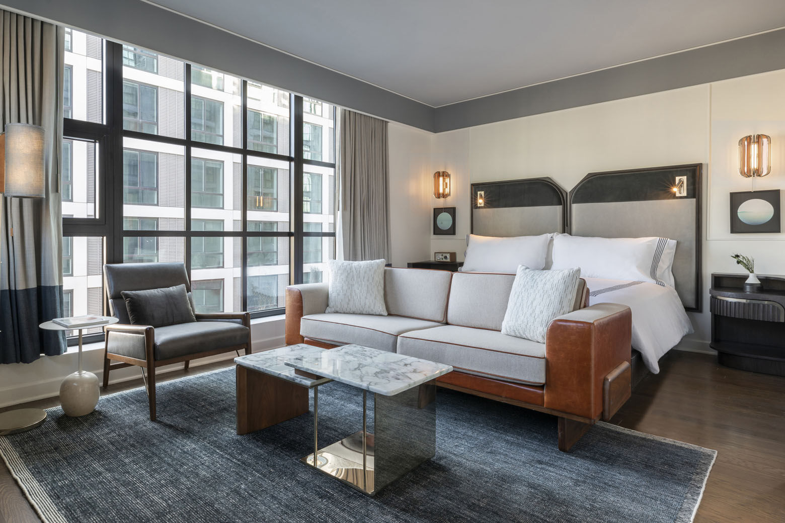 A look at the bedroom in a suite at the Thompson D.C. in the Capitol Riverfront's Navy Yard Neighborhood. The hotel's 225 rooms and suites all have floor-to-ceiling windows and views of the Anacostia River and Nationals Park.