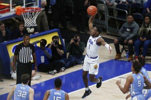 Johnson scores 20, Pitt drills reeling North Carolina 66-52